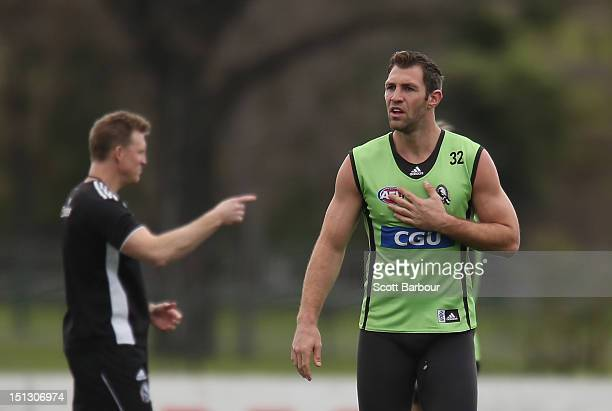 Nathan Buckley coach of the Magpies gestures as Travis Cloke of the Magpies looks on during a Collingwood Magpies AFL training session at Gosch's...