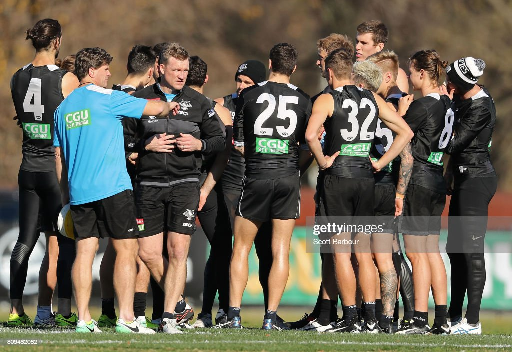 Nathan Buckley, coach of the Magpies speaks with Assistant coach Robert Harvey during a Collingwood AFL training session at the Holden Centre on July 6, 2017 in Melbourne, Australia.