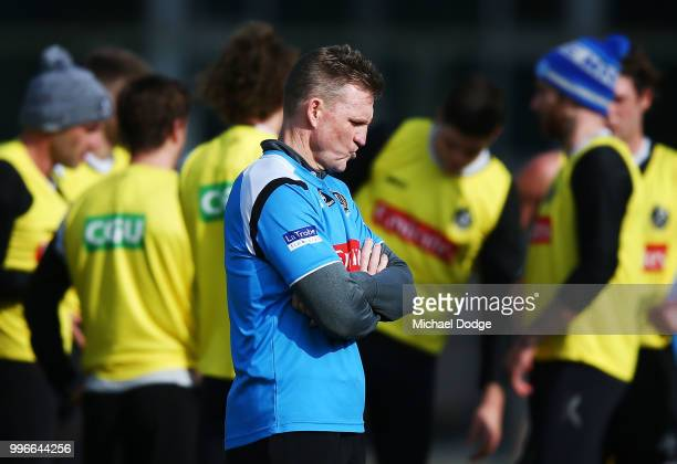 Nathan Buckley looks thoughtful during a Collingwood Magpies AFL training session at the Holden Centre on July 12 2018 in Melbourne Australia