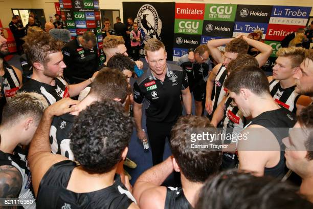 Nathan Buckley Senior Coach of the Magpies adresses his player in the rooms after the round 18 AFL match between the Collingwood Magpies and the West...