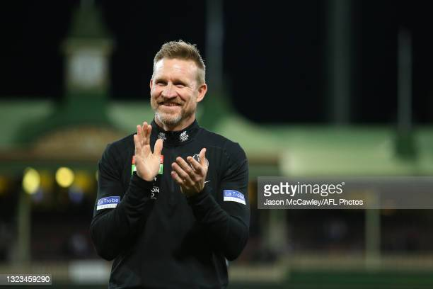 Nathan Buckley, Senior Coach of the Magpies celebrates victory during the round 13 AFL match between the Melbourne Demons and the Collingwood Magpies...