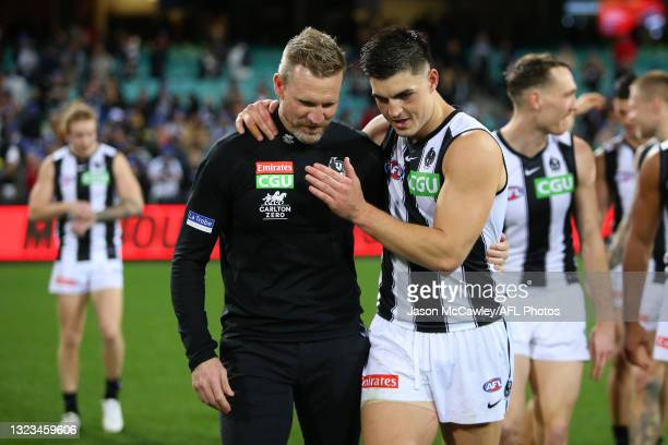 Nathan Buckley, Senior Coach of the Magpies celebrates victory with Kade Chandler of the Demons during the round 13 AFL match between the Melbourne...