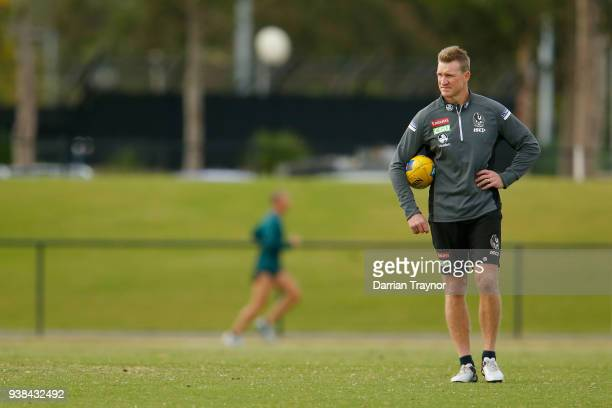 Nathan Buckley Senior Coach of the Magpies looks on during a Collingwood Magpies AFL training session at Holden Centre on March 27 2018 in Melbourne...