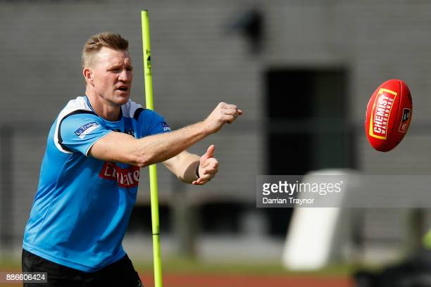 Nathan Buckley Senior Coach of the Magpies takes part during a Collingwood Magpies men's and women's joint AFL preseason training session at the...
