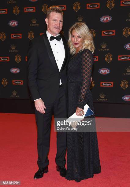 Nathan Buckley the coach of the Magpies and his wife Tania Buckley arrives ahead of the 2017 Brownlow Medal at Crown Entertainment Complex on...