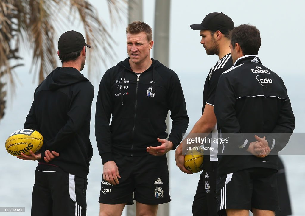Nathan Buckley the coach of the Magpies talks to Alan Didak and Chris Dawes during a Collingwod Magpies AFL recovery sessionat the St Kilda Sea Baths on September 18, 2012 in Melbourne, Australia.