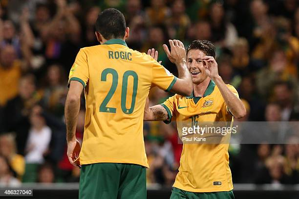 Nathan Burns of Australia celebrates a goal with Tom Rogic during the 2018 FIFA World Cup Qualification match between the Australian Socceroos and...