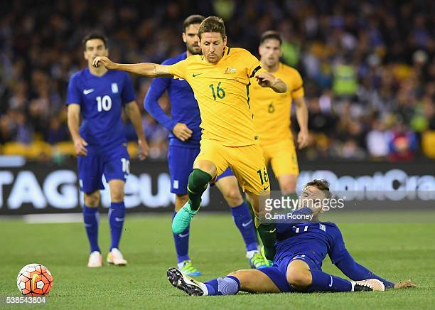 Nathan Burns of Australia is tackled by Konstantinos Stafylidis of Greece during the International Friendly match between the Australian Socceroos...