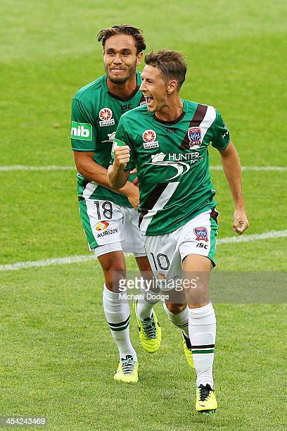 Nathan Burns of the Jets celebrates his goal with James Brown during the round nine ALeague match between the Melbourne Victory and the Newcastle...