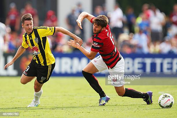 Nathan Burns of the Phoenix competes with Brendan Hamill of the Wanderers during the round 16 ALeague match between the Western Sydney Wanderers and...