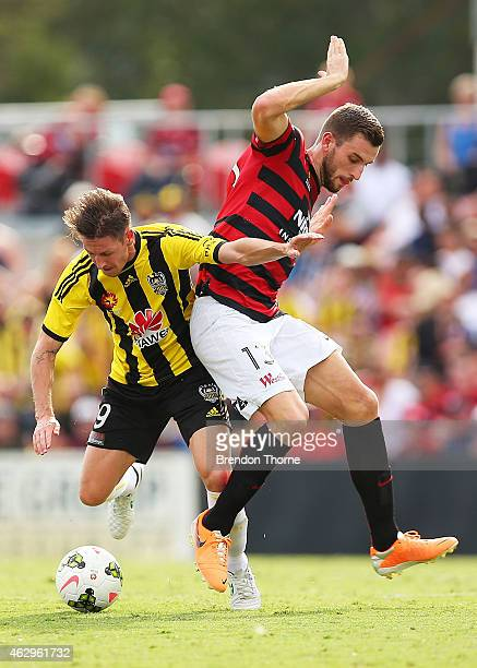 Nathan Burns of the Phoenix competes with Matthew Spiranovic of the Wanderers during the round 16 ALeague match between the Western Sydney Wanderers...