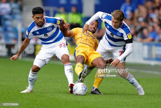 Nathan Byrne of Wigan Athletic Massimo Luongo and Luke Freeman of Queens Park Rangers during the Sky Bet Championship match between Queens Park...