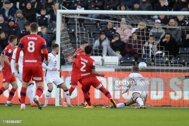 Nathan Byrne of Wigan Athletic scores a goal during the Sky Bet Championship match between Swansea City and Wigan Athletic at the Liberty Stadium on...