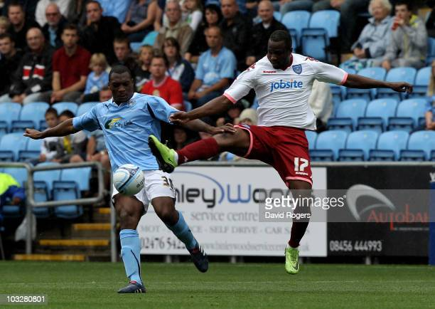 Nathan Cameron of Coventry City is challenged by John Utaka during the npower Championship match between Coventry City and Portsmouth at the Ricoh...