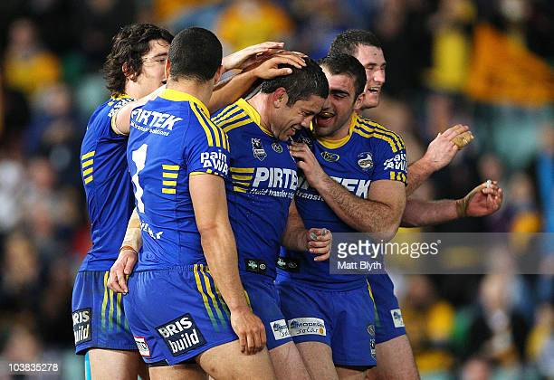 Nathan Cayless of the Eels is congratulated by team mates after scoring a try in his last match during the round 26 NRL match between the Parramatta...