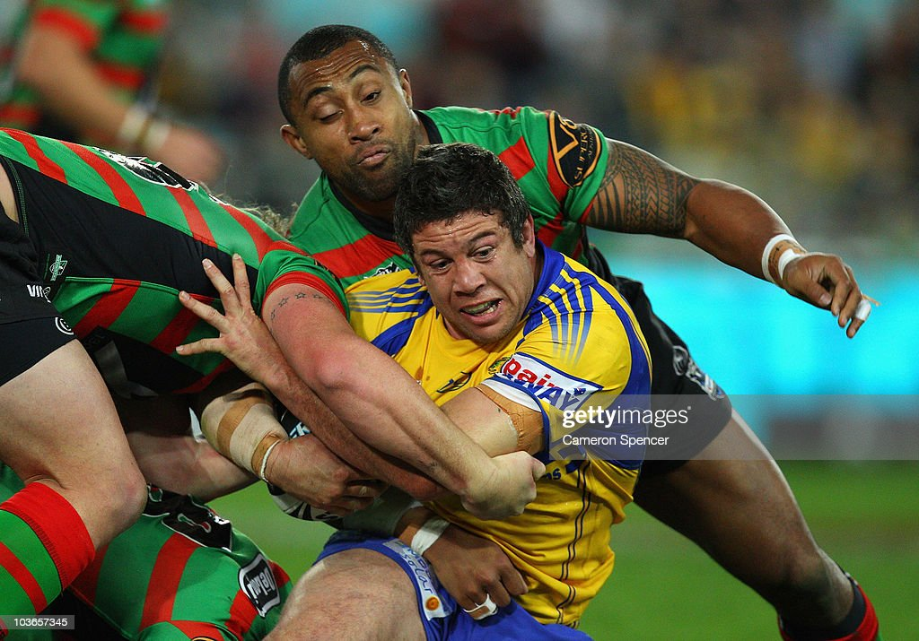 Nathan Cayless of the Eels is tackled during the round 25 NRL match between the South Sydney Rabbitohs and the Parramatta Eels at ANZ Stadium on August 27, 2010 in Sydney, Australia.