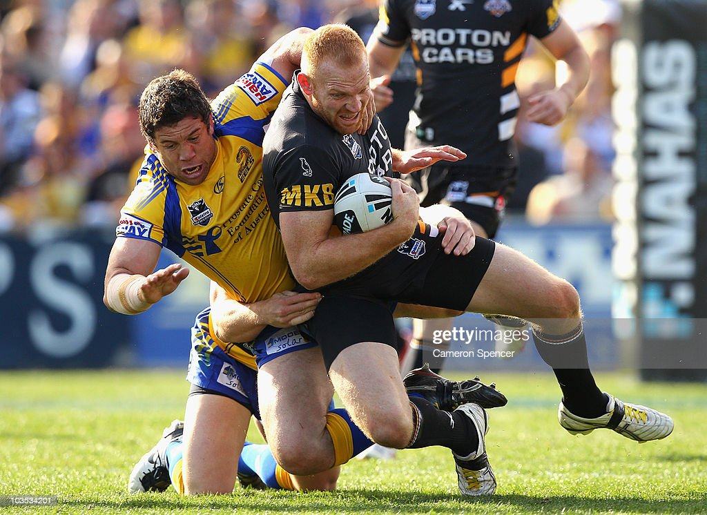 Nathan Cayless of the Eels tackles Keith Galloway of the Tigers during the round 24 NRL match between the Parramatta Eels and the Wests Tigers at Parramatta Stadium on August 22, 2010 in Sydney, Australia.