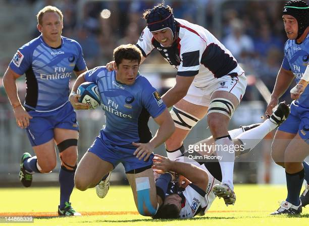 Nathan Charles of the Force is tackled during the round 13 Super Rugby match between the Western Force and the Melbourne Rebels at NIB Stadium on May...