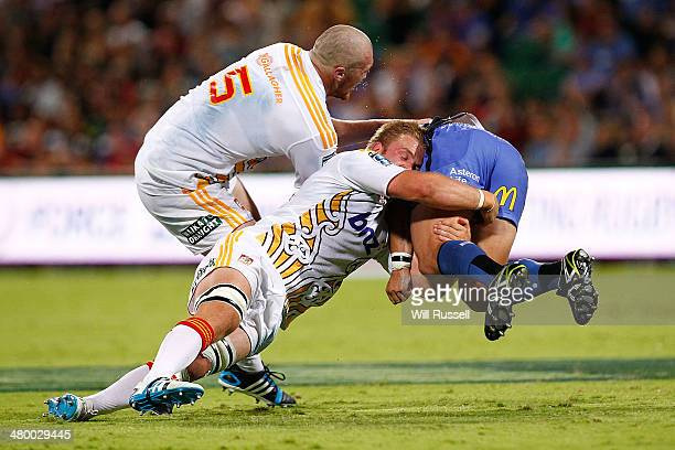 Nathan Charles of the Force is tackled during the round six Super Rugby match between the Force and the Chiefs at nib Stadium on March 22 2014 in...