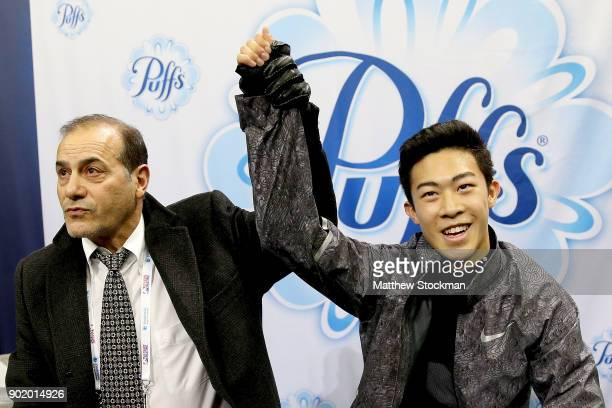 Nathan Chen celebrates in the kiss and cry with his coach Rafael Arutunian after skating in the the Men's Free Skate during the 2018 Prudential US...