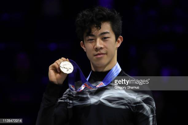 Nathan Chen holds up his gold medal after winning the men's championship during the 2019 US Figure Skating Championships at Little Caesars Arena on...