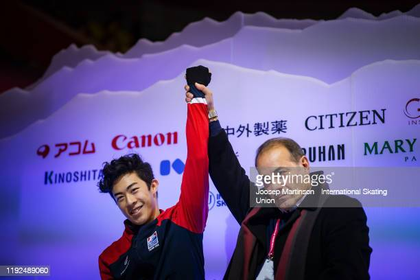 Nathan Chen of the United States and his coach Rafael Arutunian react at the kiss and cry in the Men's Free Skating during the ISU Grand Prix of...