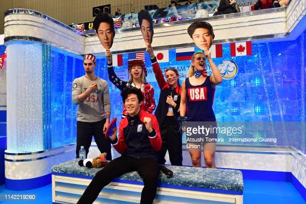 Nathan Chen of the United States celebrates after his score was announced at the kiss and cry with his team matesafter competing in the Men's Single...
