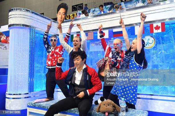 Nathan Chen of the United States celebrates his score with his team mates at the kiss and cry after competing in the Men's Single Short Program on...