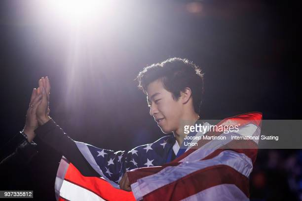 Nathan Chen of the United States is congratulated in the Men's medal ceremony during day four of the World Figure Skating Championships at Mediolanum...