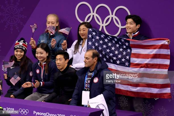 Nathan Chen of the United States looks on with teammates after competing in the Figure Skating Team Event Men's Single Skating Short Program during...