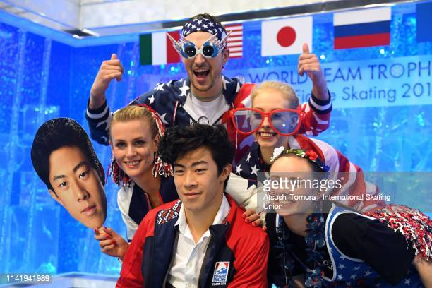Nathan Chen of the United States waits for his score with his team mates at the kiss and cry after competing in the Men's Single Short Program on day...