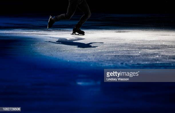 Nathan Chen of the USA casts a shadow as he performs during the Skating Spectacular on day three of the 2018 ISU Grand Prix of Figure Skating Skate...