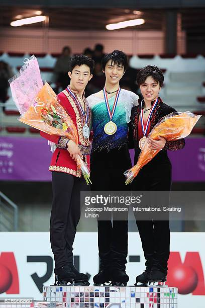 Nathan Chen of United States Yuzuru Hanyu of Japan and Shoma Uno of Japan pose during Senior Men's medal ceremony on day three of the ISU Junior and...