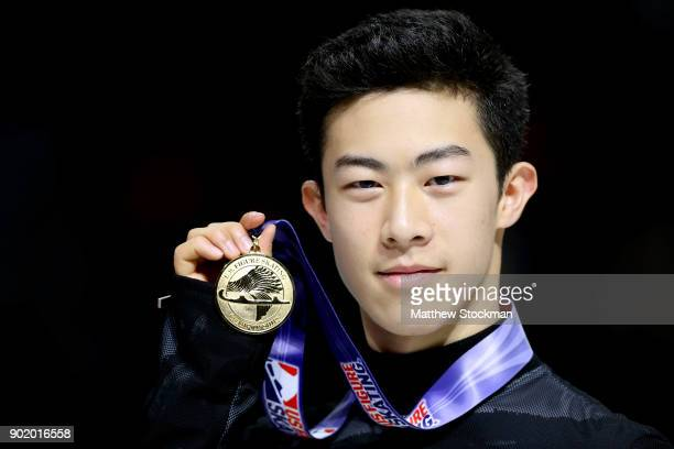 Nathan Chen poses for photographers after the medal ceremony for the Championship Men's during the 2018 Prudential US Figure Skating Championships at...
