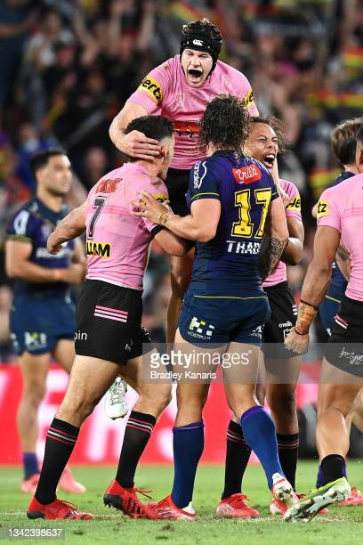 Nathan Cleary, Matt Burton and Jerome Luai of the Panthers celebrate victory during the NRL Preliminary Final match between the Melbourne Storm and...