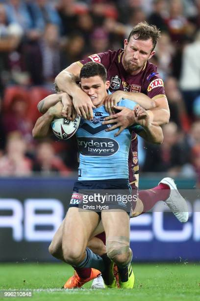 Nathan Cleary of the Blues is tackled by Gavin Cooper of the Maroons during game three of the State of Origin series between the Queensland Maroons...