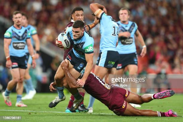Nathan Cleary of the Blues is tackled during game three of the State of Origin series between the Queensland Maroons and the New South Wales Blues at...