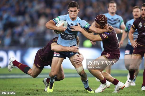 Nathan Cleary of the Blues is tackled during game two of the State of Origin series between the New South Wales Blues and the Queensland Maroons at...