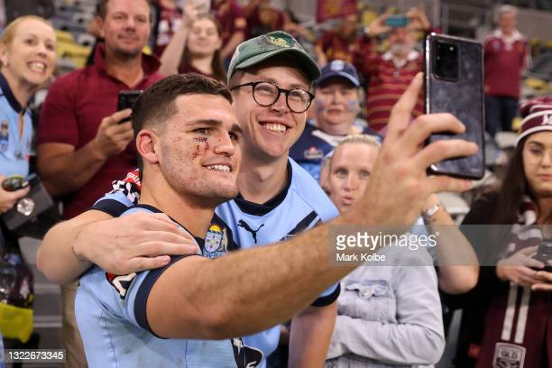 Nathan Cleary of the Blues poses with fans after winning game one of the 2021 State of Origin series between the New South Wales Blues and the...