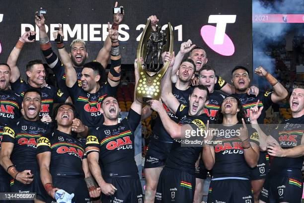 Nathan Cleary of the Panthers and Isaah Yeo of the Panthers hold aloft the Premiership Trophy after winning the 2021 NRL Grand Final match between...