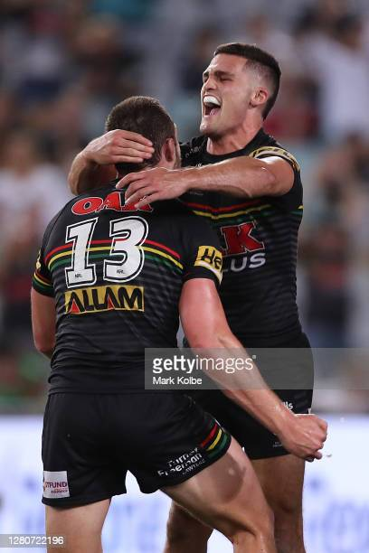 Nathan Cleary of the Panthers and Isaah Yeo of the Panthers celebrates the try scored by Dylan Edwards during the NRL Preliminary Final match between...