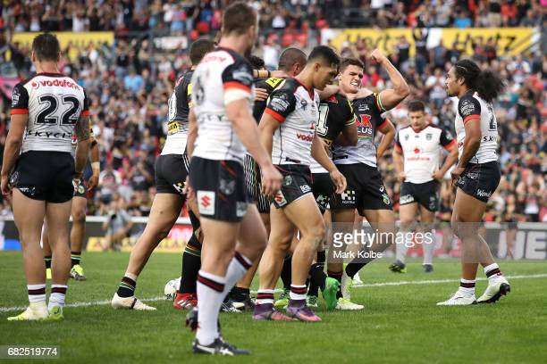 Nathan Cleary of the Panthers celebrates as Matt Moylan of the Panthers celebrates with his team mates after scoring a try during the round 10 NRL...