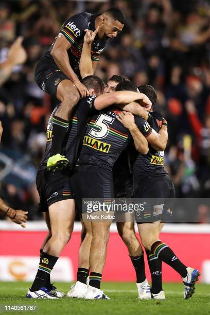 Nathan Cleary of the Panthers celebrates with his team mates after kicking the winning field goal in golden point during the round four NRL match...