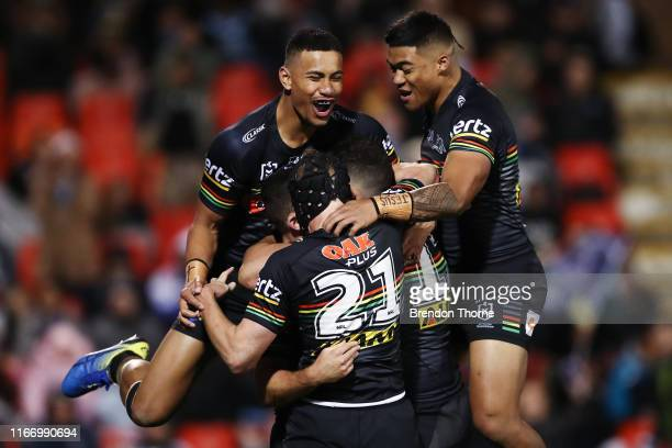 Nathan Cleary of the Panthers celebrates with team mates after scoring a try during the round 21 NRL match between the Penrith Panthers and the...