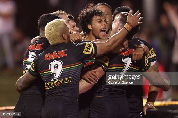 Nathan Cleary of the Panthers celebrates with team mates after scoring a try during the NRL Qualifying Final match between the Penrith Panthers and...