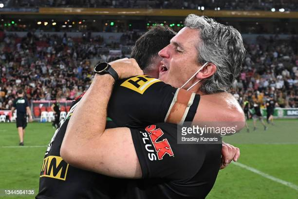 Nathan Cleary of the Panthers hugs his father and coach Ivan Cleary after winning the 2021 NRL Grand Final match between the Penrith Panthers and the...