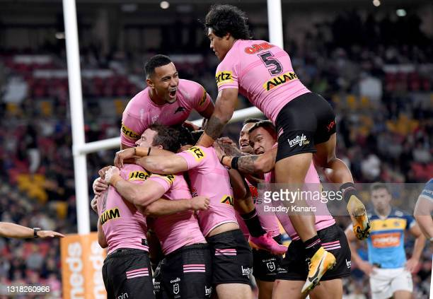Nathan Cleary of the Panthers is congratulated by team mates after scoring a try during the round 10 NRL match between the Gold Coast Titans and the...