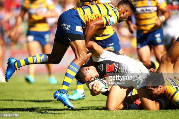 Nathan Cleary of the Panthers is tackled bt Bevan French and Tepai Moeroa of the Eels during the round one NRL match between the Penrith Panthers and...