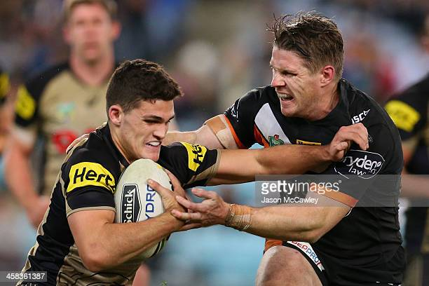 Nathan Cleary of the Panthers is tackled by Chris Lawrence of the Tigers during the round 17 NRL match between the Wests Tigers and the Penrith...