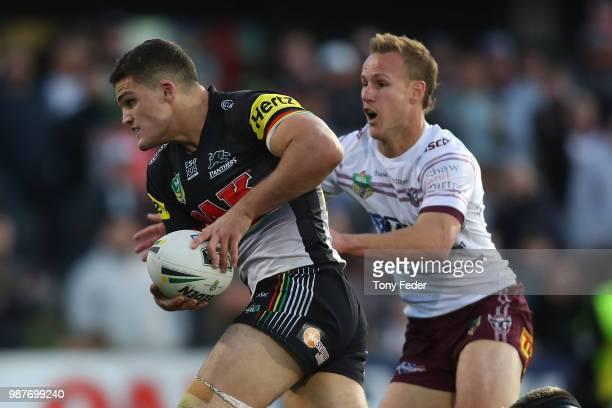 Nathan Cleary of the Panthers is tackled by Daly Cherry-Evans of the Sea Eagles during the round 16 NRL match between the Penrith Panthers and the...
